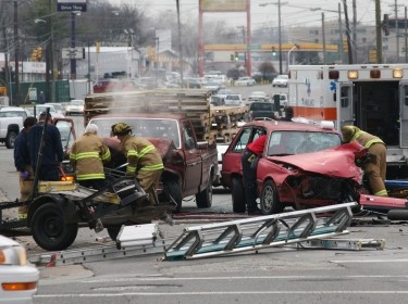 Emergency responders helping at a traffic accident