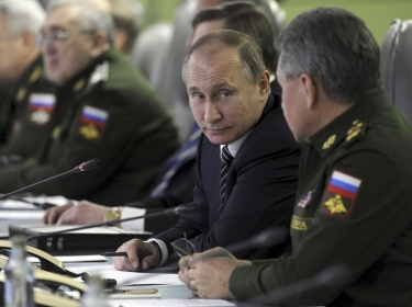 Russian President Vladimir Putin and Defense Minister Sergei Shoigu in a meeting dealing with the commissioning of military products at the National Defense Control Center in Moscow, March 11, 2016