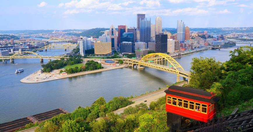 The Duquesne Incline operates in front of the downtown skyline of Pittsburgh, Pennsylvania