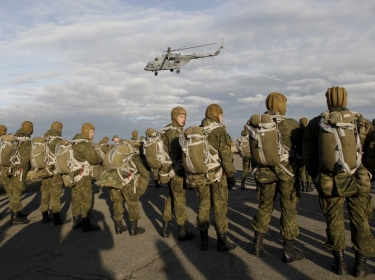 Russian paratroopers wait to board a helicopter during a military exercise outside the southern city of Stavropol, Russia, October 27, 2015