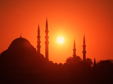 The sun sets over Suleymaniye Mosque in Istanbul, Turkey