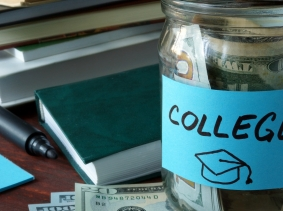 "Jar with ""college"" label and money, photo by designer491/Fotolia"