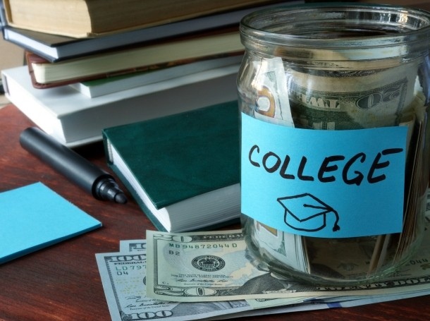 """Jar with """"college"""" label and money"""