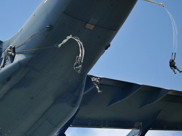 U.S. Army paratroopers jump from a C-17 Globemaster III over the Juliet Drop Zone in Pordenone, Italy, June 12, 2013