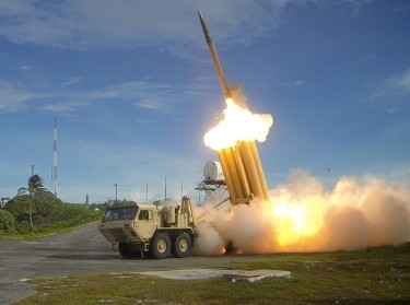 Two THAAD interceptors and a Standard-Missile 3 Block IA missile being launched at a test site