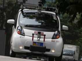 A self-driving vehicle travels on the road during a demonstration in Singapore, October 12, 2015
