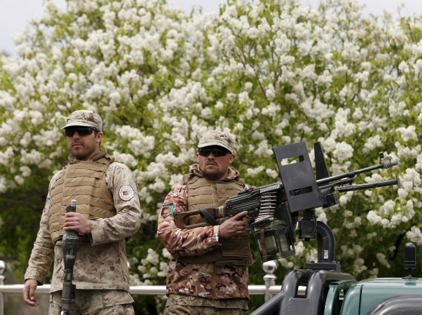 Afghan security forces keep watch after a suicide car bomb attack on a government security building in Kabul, Afghanistan, April 19, 2016