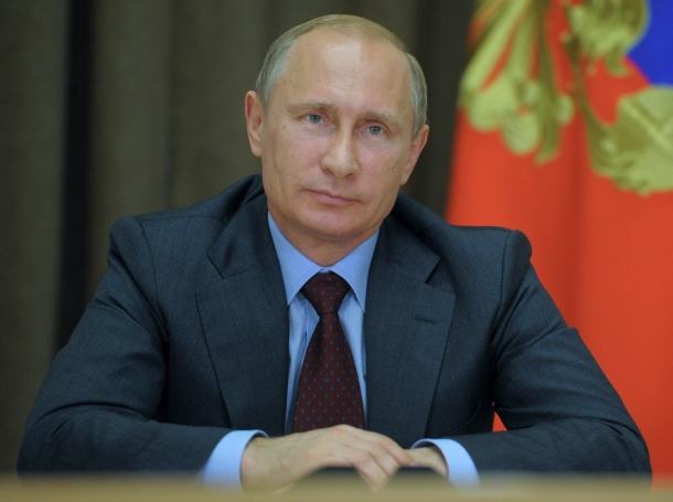 Russian President Vladimir Putin attends a video conference with Arctic oil drilling platform West Alpha in Sochi, August 9, 2014