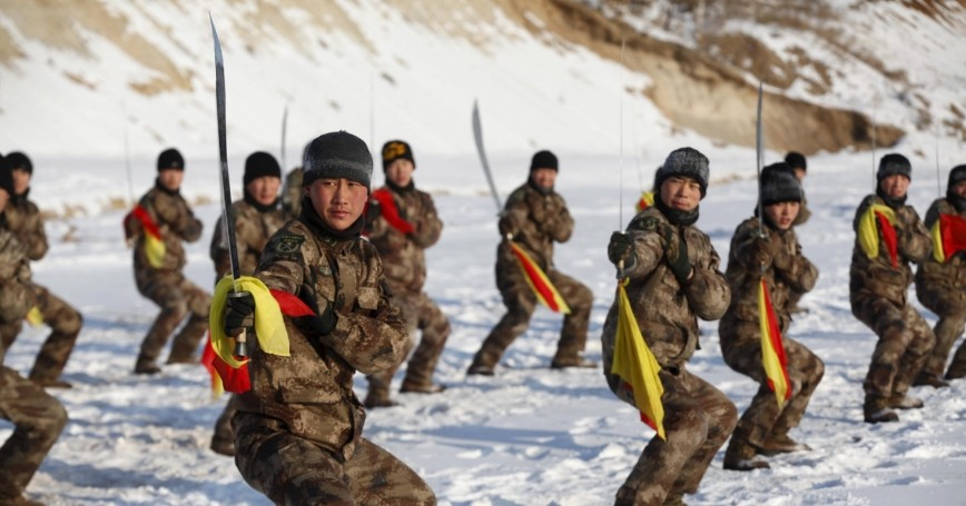 Soldiers of China's PLA take part in winter training at temperatures around -22 degrees Fahrenheit at China's border with Russia in Heihe, Heilongjiang province, January 31, 2016