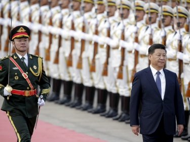 China's President Xi Jinping reviews an honour guard during a welcoming ceremony for Nigerian President Muhammadu Buhari (not pictured) at the Great Hall of the People in Beijing, China, April 12, 2016
