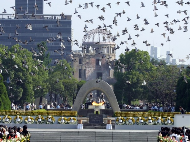 Doves fly over the Peace Memorial Park with a view of the gutted A-bomb dome at a ceremony in Hiroshima, Japan