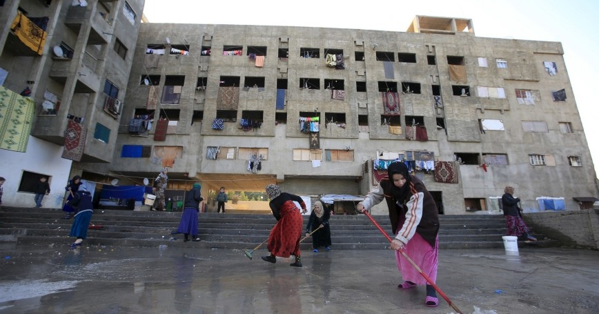 Women cleaning a compound housing Syrian refugees in Sidon, Lebanon, February 3, 2016
