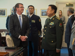 U.S. Defense Secretary Ash Carter, left, gives Chinese Gen. Fan Changlong, vice chairman of China's Central Military Commission, a tour of his office at the Pentagon, June 11, 2015