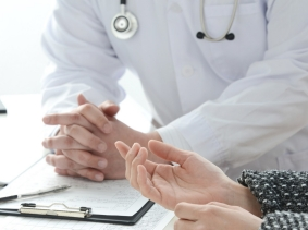A doctor and patient interacting, photo by takasu/Fotolia