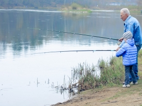 Grandfather and grandson fishing, photo by ruslimonchyk/Fotolia