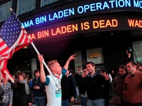 People react to the death of Osama bin Laden in Times Square in New York City, May 2, 2011