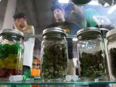 People look at products at the medical marijuana farmers market at the California Heritage Market in Los Angeles, California July 11, 2014