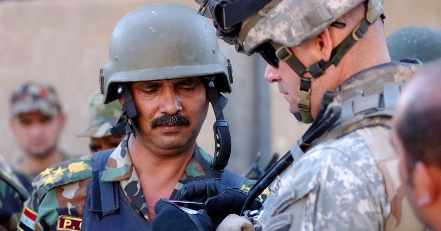 U.S. and Iraqi officers checking IDs in Baghdad, Iraq, October 2006