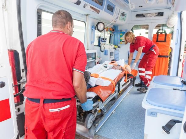 Paramedics helping a patient