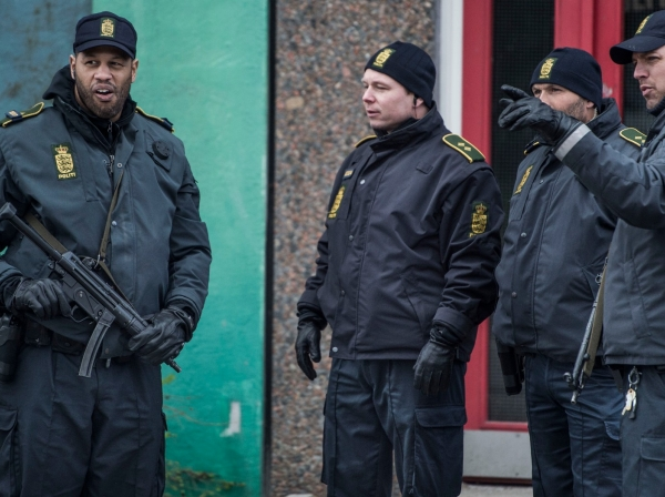 Danish police search an apartment block in Ishoej, Denmark, for people suspected of having been recruited by the Islamic State, April 7, 2016