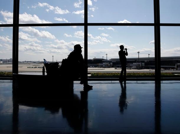 A boy takes pictures at Narita International airport in Narita, Japan, March 25, 2016
