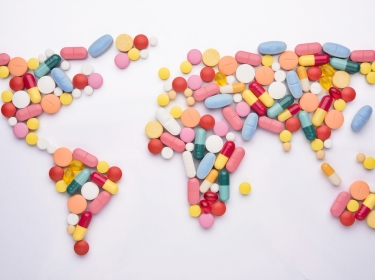 A world map shaped with pharmaceutical drugs
