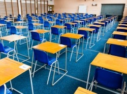 Rows of empty desks in a school