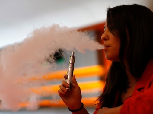 Brandy Tseu uses an electronic cigarette at The Vapor Spot vapor bar in Los Angeles, California, March 4, 2014