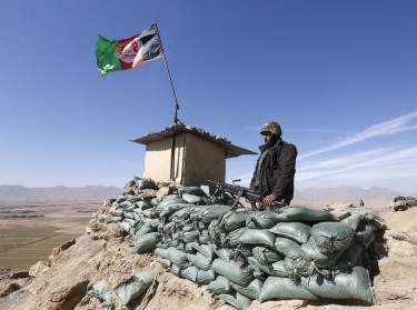 An Afghan National Army soldier keeps watch at a check post in Logar province, Afghanistan, February 16, 2016
