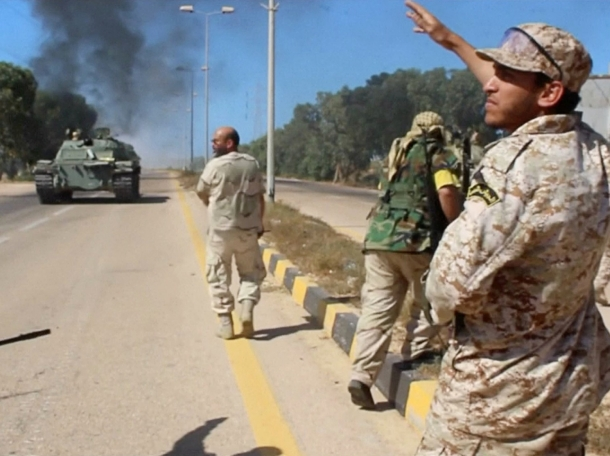 Soldiers from a force aligned with Libya's new unity government walk along a road during an advance on the eastern and southern outskirts of the Islamic State stronghold of Sirte, June 9, 2016