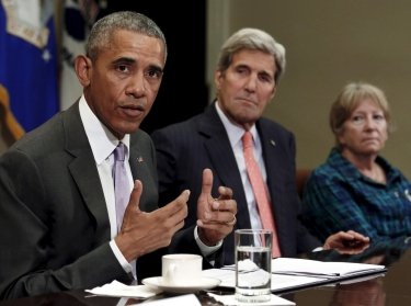 U.S. Secretary of State John Kerry (center) listens as President Barack Obama meets with veterans and Gold Star Mothers about the Iran nuclear deal at the White House in Washington, DC, September 10, 2015