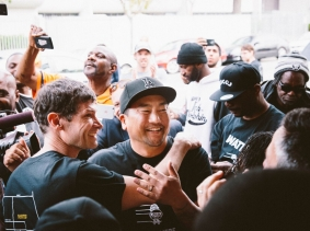 Chefs Daniel Patterson (left) and Roy Choi (center) celebrate during a ribbon-cutting ceremony at the restaurant Locol in the Watts neighborhood of Los Angeles, California, photo by Audrey Ma