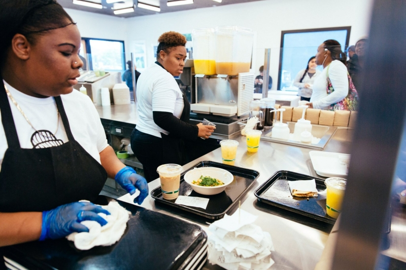 Staff work in the kitchen at the restaurant Locol in the Watts neighborhood of Los Angeles, California