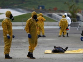 Brazilian Army soldiers take part in a simulation of decontamination of multiple victims during a training against chemical, biological, radiological, and nuclear attacks ahead of the 2016 Rio Olympics, March 11, 2016, photo by Ricardo Moraes/Reuters