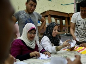 Officials count the ballots after the polls are closed in Cairo, Egypt, June 17, 2012