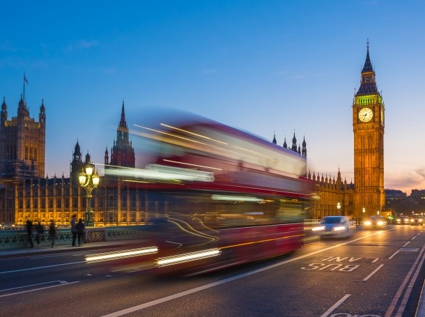 Double decker bus going by Big Ben and Parliament in London, UK