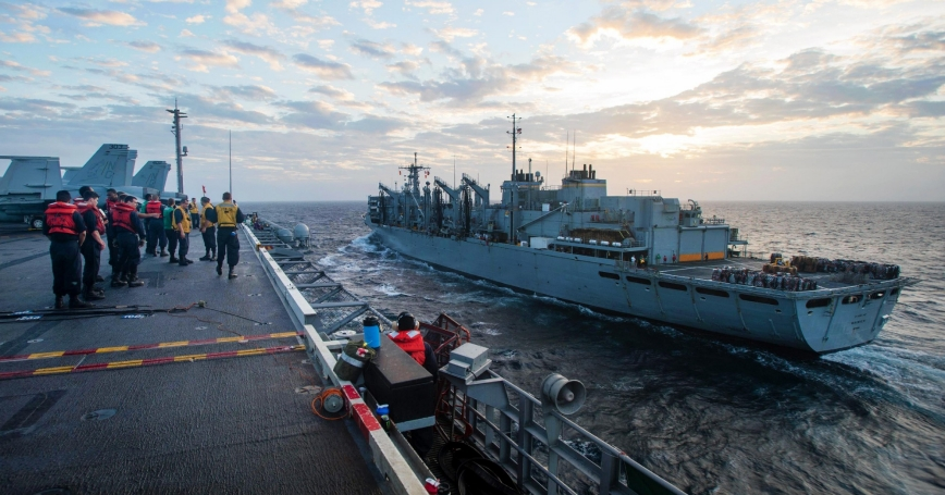 The aircraft carrier USS John C. Stennis approaches the fast combat support ship USNS Rainier during a replenishment at sea in the South China Sea, March 4, 2016