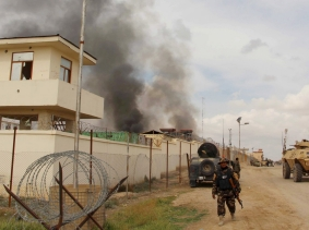 ISmoke billows from a building after a Taliban attack in Gereshk district of Helmand province, Afghanistan, March 9, 2016