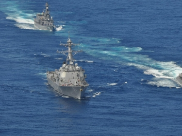 The guided-missile destroyer USS Chafee (DDG 90), left, and the Japan Maritime Self-Defense Force destroyers JS Yamayuki (DD-129) and JS Yamagiri (DD-152) conduct formation drills during a passing exercise