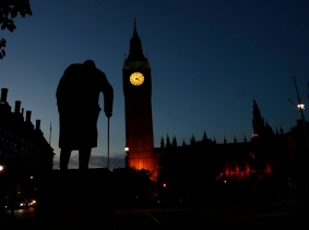 Dawn breaks behind the Houses of Parliament and the statue of Winston Churchill in Westminster, London, Britain, June 24, 2016, photo by Stefan Wermuth/Reuters