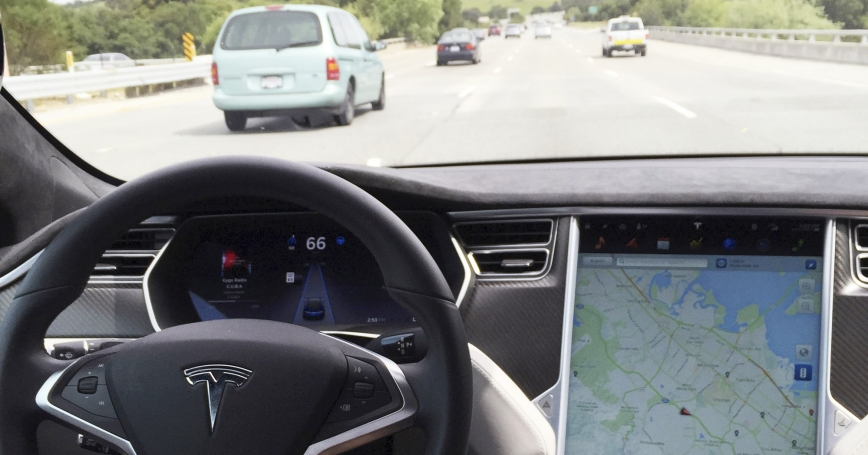 The interior of a Tesla Model S is shown in autopilot mode in San Francisco, California, April 7, 2016