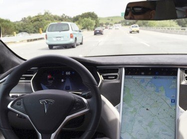The interior of a Tesla Model S is shown in autopilot mode in San Francisco, California, April 7, 2016