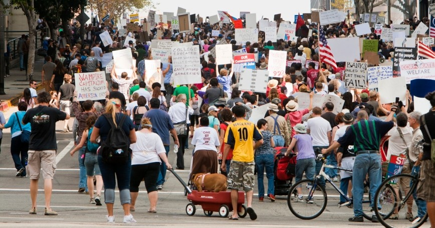 Demonstrators march in the Occupy LA protest through downtown Los Angeles to City Hall on October 15, 2011