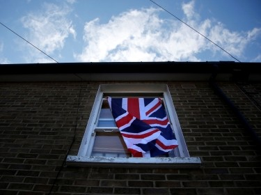A British flag flutters in front of a window in London, Britain, June 24, 2016 after Britain voted to leave the European Union in the EU BREXIT referendum.