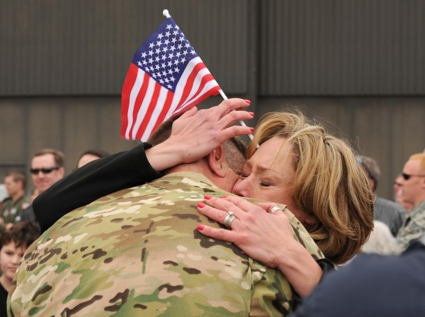 A spouse embraces her husband after he returned from a four-month deployment May 18, 2016, at Peterson Air Force Base, Colorado
