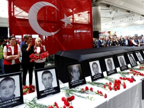 Employees at Atatürk Airport attend a ceremony for their coworkers who were killed in an attack at the airport, Istanbul, Turkey, June 30, 2016, photo by Murad Sezer/Reuters