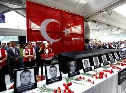 Employees at Atatürk Airport attend a ceremony for their coworkers who were killed in an attack at the airport, Istanbul, Turkey, June 30, 2016