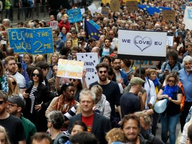 People hold banners during a March for Europe demonstration against Britain's decision to leave the European Union, in central London, Britain, July 2, 2016