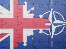 Puzzle with the flags of Great Britain and NATO, photo by luzitanija/Fotolia