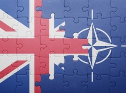 Puzzle with the flags of Great Britain and NATO